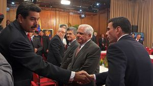 "Venezuelan President Nicolas Maduro (L) greets opposition leader Henrique Capriles (R) before a meeting with Venezuelan opposition leaders and Latin American Foreign Affairs Ministers at the Miraflores presidential palace in Caracas on April 10, 2014. Maduro sat down for talks with rival Henrique Capriles in a first meeting with senior opposition figures to try to end two months of protests. The televised meeting, which involved about 20 representatives from both sides, was also witnessed by the foreign ministers of Brazil, Colombia and Ecuador, and a Vatican representative. AFP PHOTO / PRESIDENCIA    == RESTRICTED TO EDITORIAL  USE / MANDATORY CREDIT:  ""AFP PHOTO /  Presidencia""/  NO SALES / NO MARKETING / NO ADVERTISING CAMPAIGNS / DISTRIBUTED AS A SERVICE TO CLIENTS =="