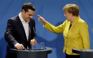German Chancellor Angela Merkel, right, points as she and the Prime Minister of Greece Alexis Tsipras leave after a press conference as part of a meeting at the chancellery in Berlin, Germany, Monday, March 23, 2015. (AP Photo/Michael Sohn)