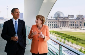 FILE - A handout picture dated 19 June 2013 shows US President Barack Obama talking to German Chancellor Angela Merkel (CDU) on the roof of the Federal Chancellery inBerlin, Germany. Merkel turns 60 on 17 July 2014. Photo: Steffen Kugler/Bundespresseamt/dpa