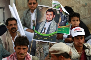 Yemeni supporters of the Shiite Huthi movement hold a portrait of the movement's leader Abdul-Malik al-Houthi during a demonstration against what they call foreign interference in Yemeni politics on February 27, 2015 in the capital Sanaa. Yemen's President Abedrabbo Mansour Hadi met on February 26, 2015 with UN envoy Jamal Benomar in Aden, as the southern city increasingly became the country's de facto political and diplomatic capital instead of militia-held Sanaa. AFP PHOTO / MOHAMMED HUWAIS