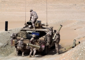 UAE soldiers load their military vehicle with rockets during manoeuvres with the French army in the desert of Abu Dhabi May 2, 2012.  AFP PHOTO/KARIM SAHIB
